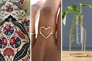 Patterned pillow covers, a hear-shaped ring, and a plant in a cute vial