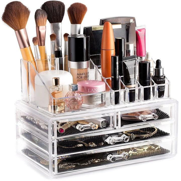 the acrylic makeup organizer with two large drawers, two smaller ones, and room to organize at the top