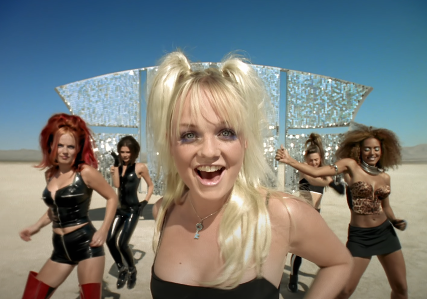 A screenshot from Spice Girls' Say You'll Be There music video of them in the desert