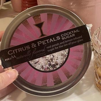 A container of citrus petals rim sugar