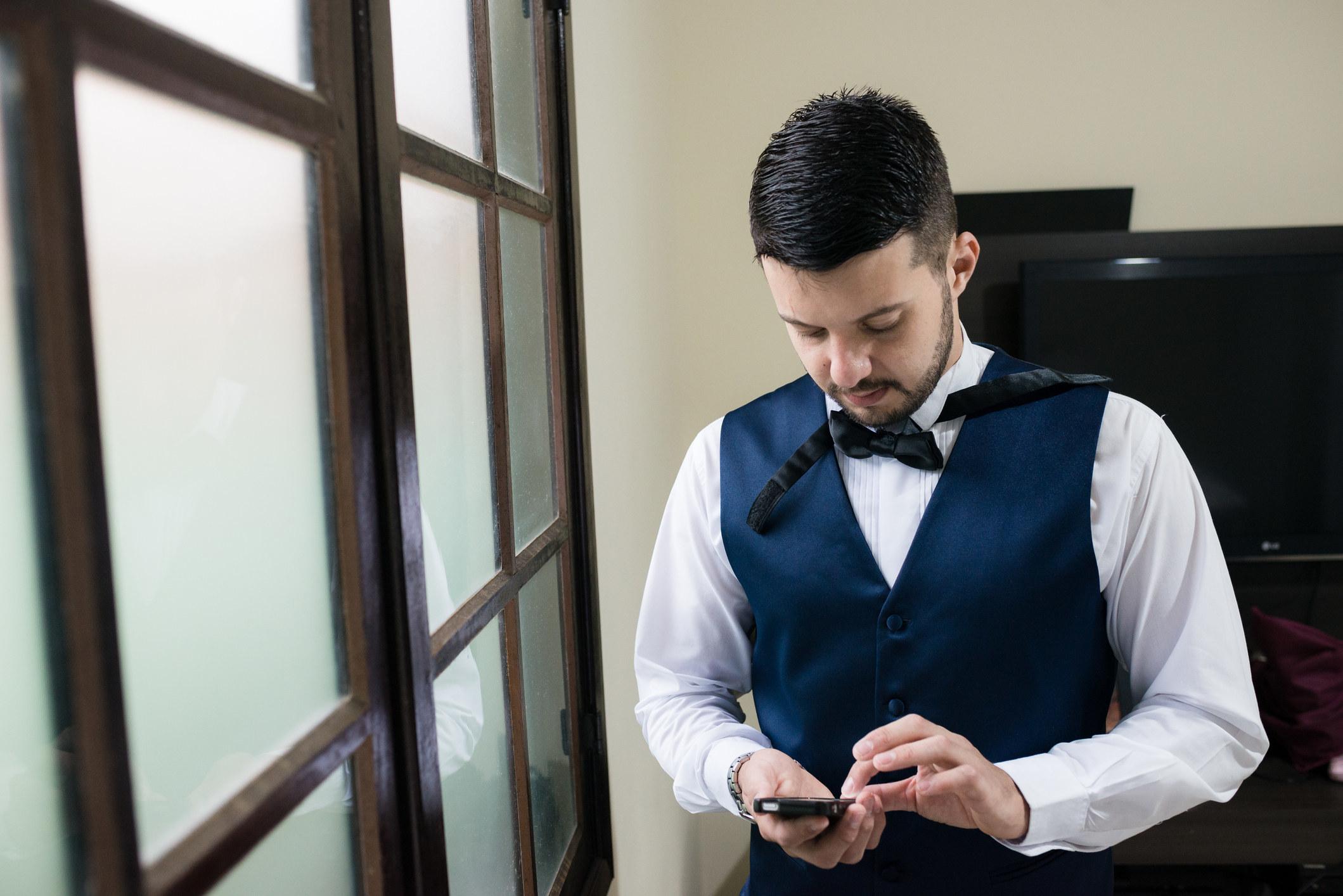 Groom texting