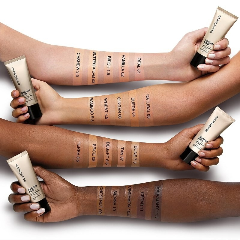 four models of various skin tones with the shades swatched on their arms