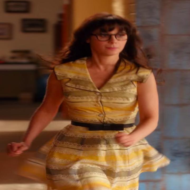 Jess wearing a dress with a belt