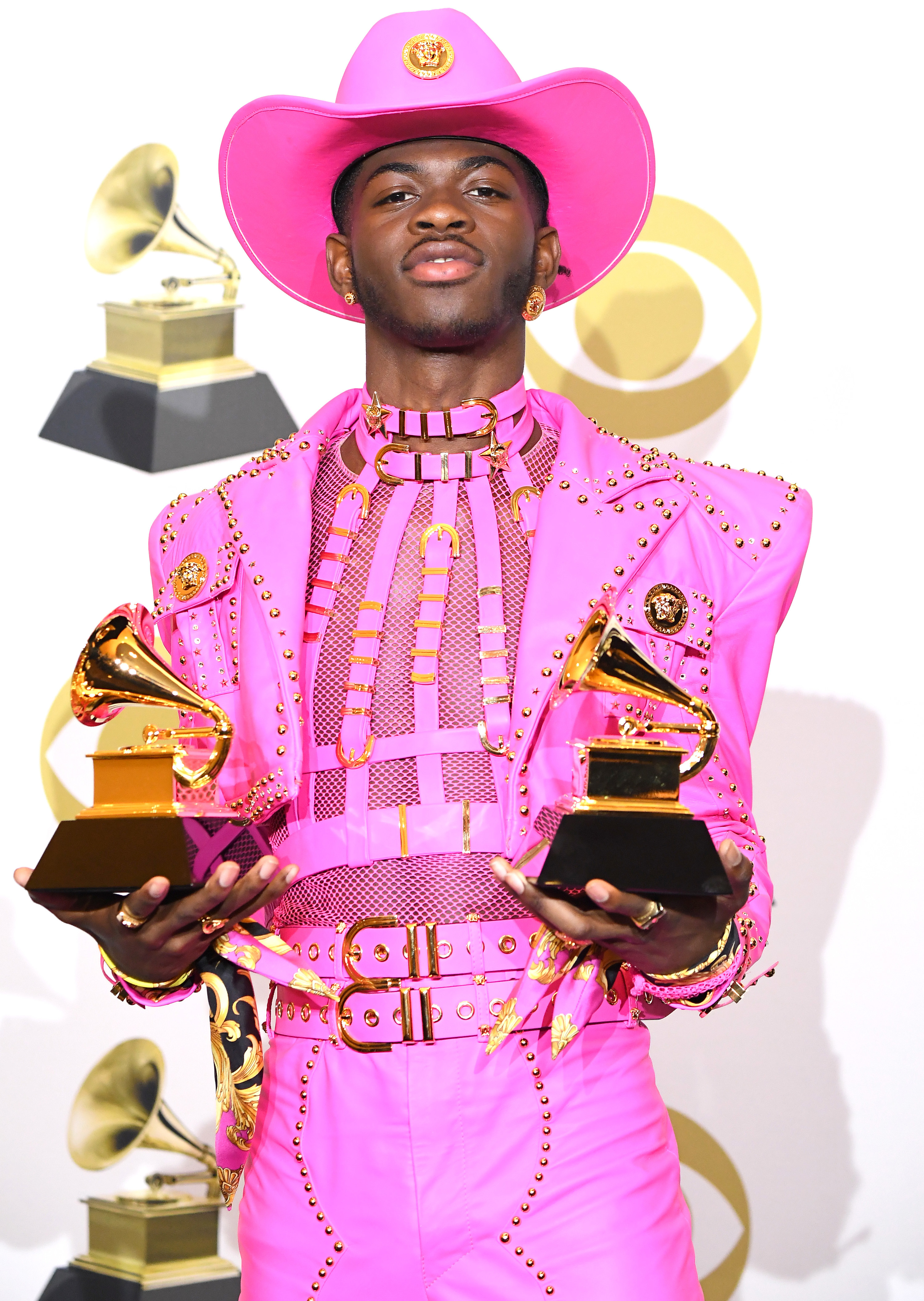 Lil' Nas X holding two Grammys