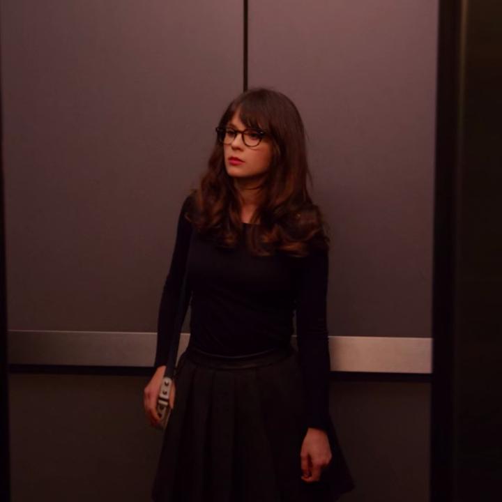 Jess wearing a long-sleeve shirt and a skirt