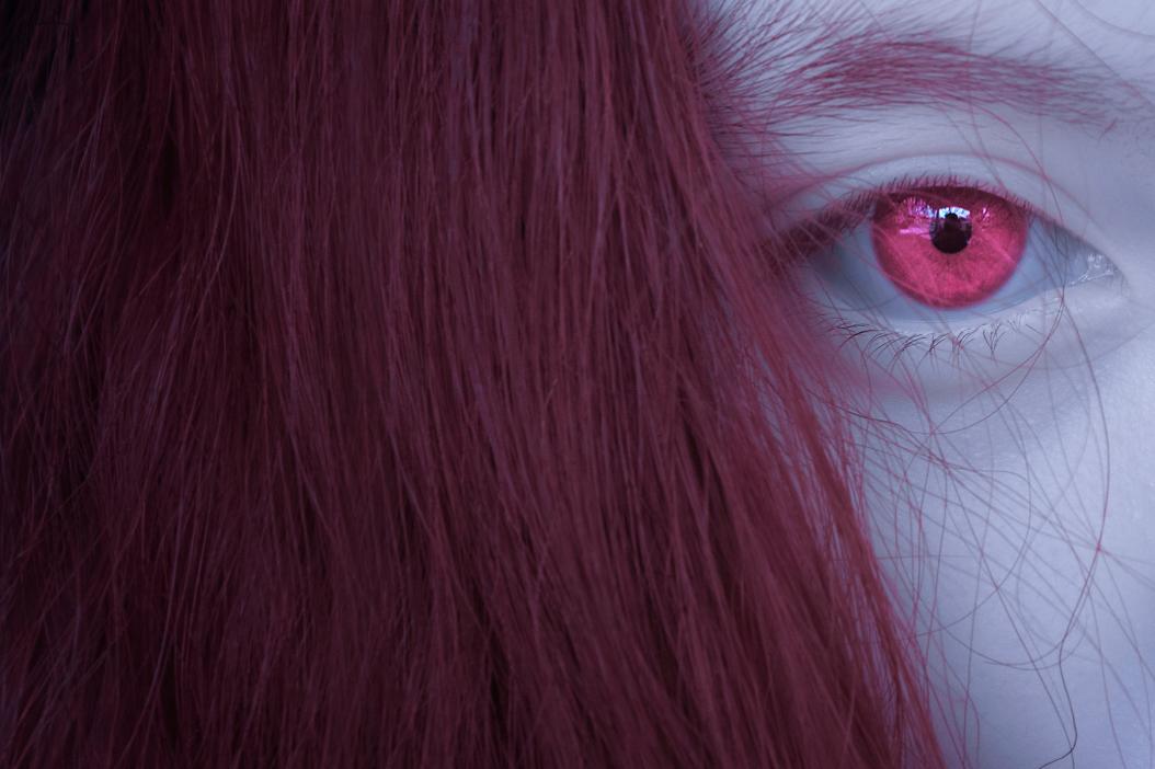 Woman with pink iris eye