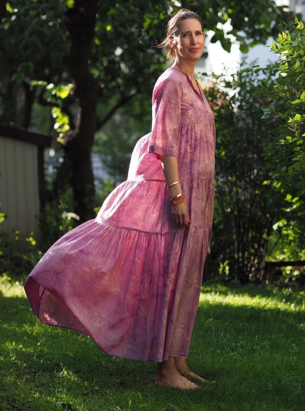 A model wearing the Sewa dress