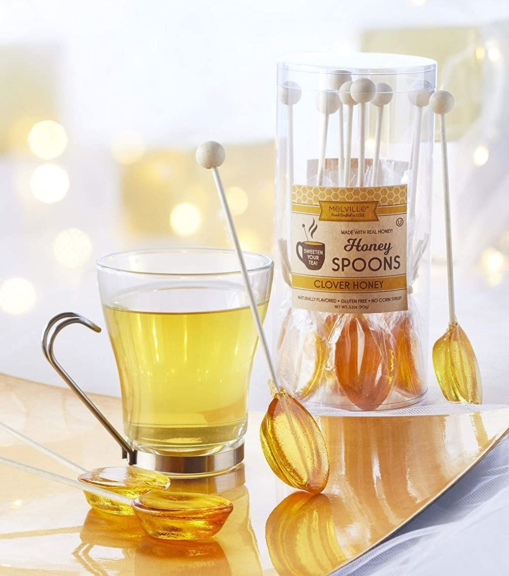 The honey clover spoons with a glass cup of tea