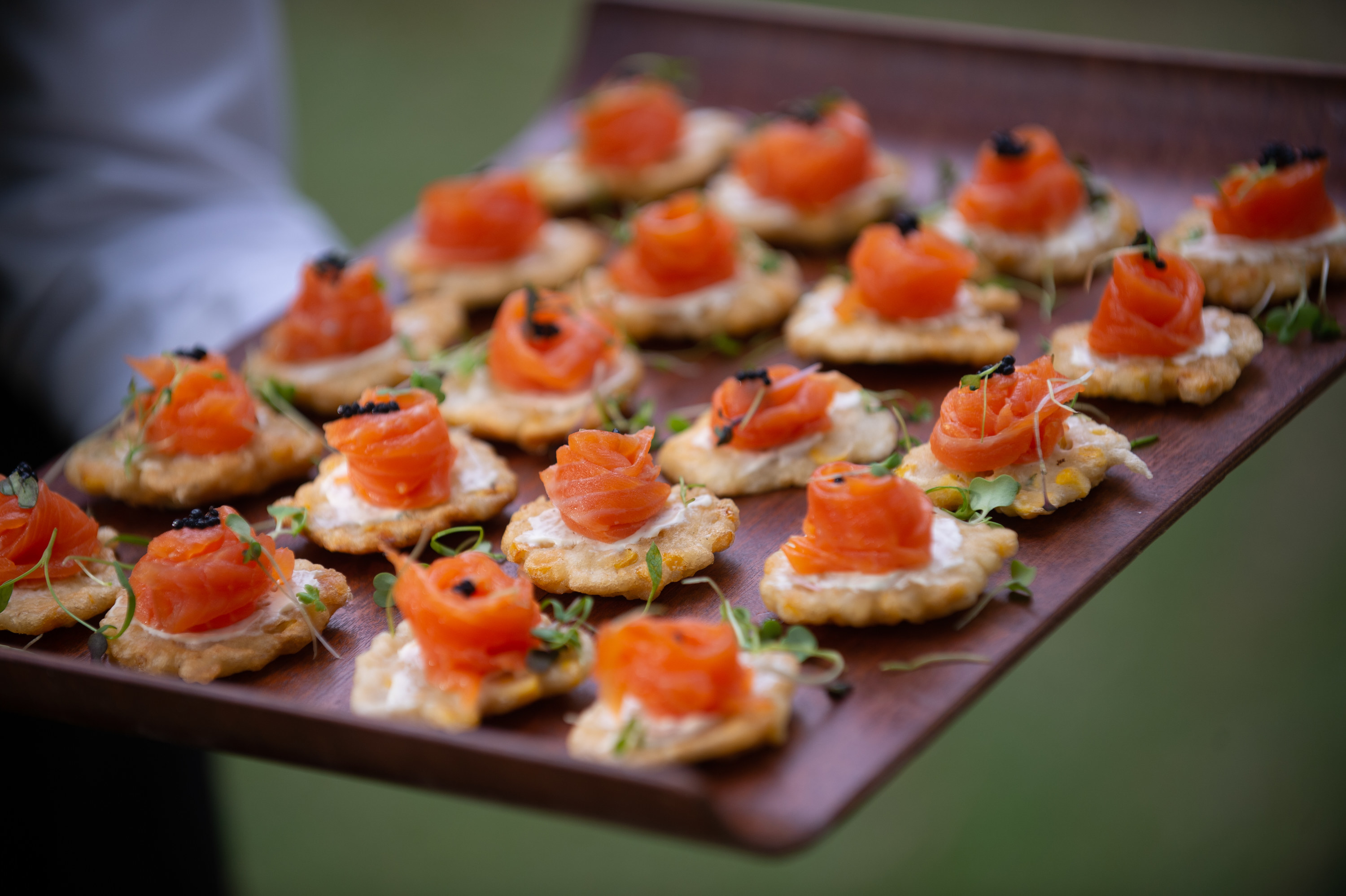 Server carrying appetizers on a tray