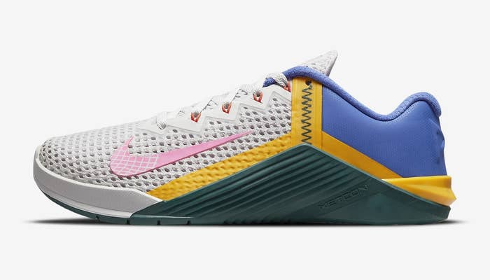 Nike Metacon 6 training shoe with white, blue, pink, yellow, and green detailing