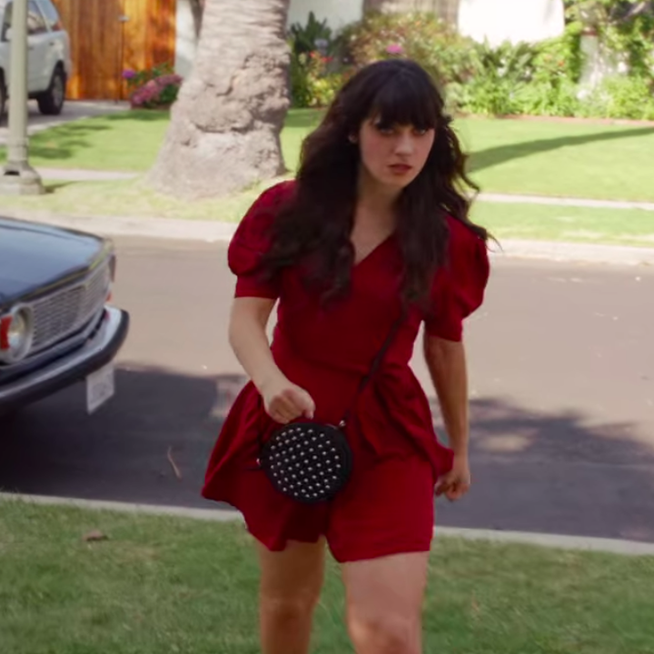 Jess wearing a dress with flats and a bag
