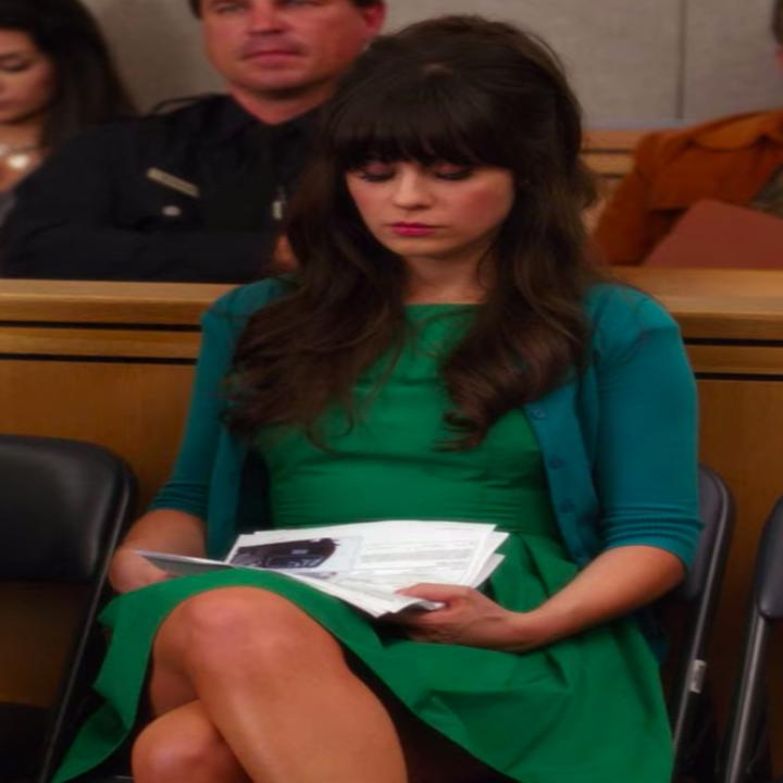 Jess wearing a dress and a cardigan