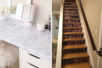 to the left: a marbled desk, to the right: stairs lined with faux bookcases in between each one