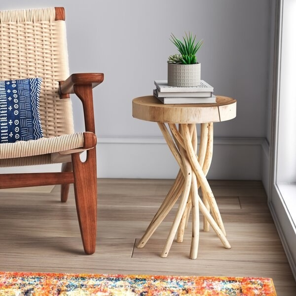 the end table with a base of intertwined sticks in a corner