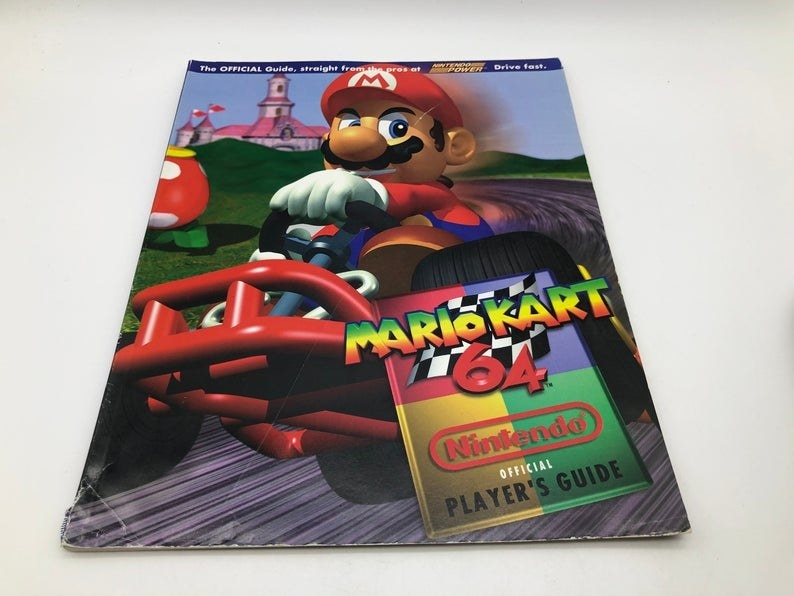 A Players Guide for Mario Kart 64 with Mario driving a kart on the cover