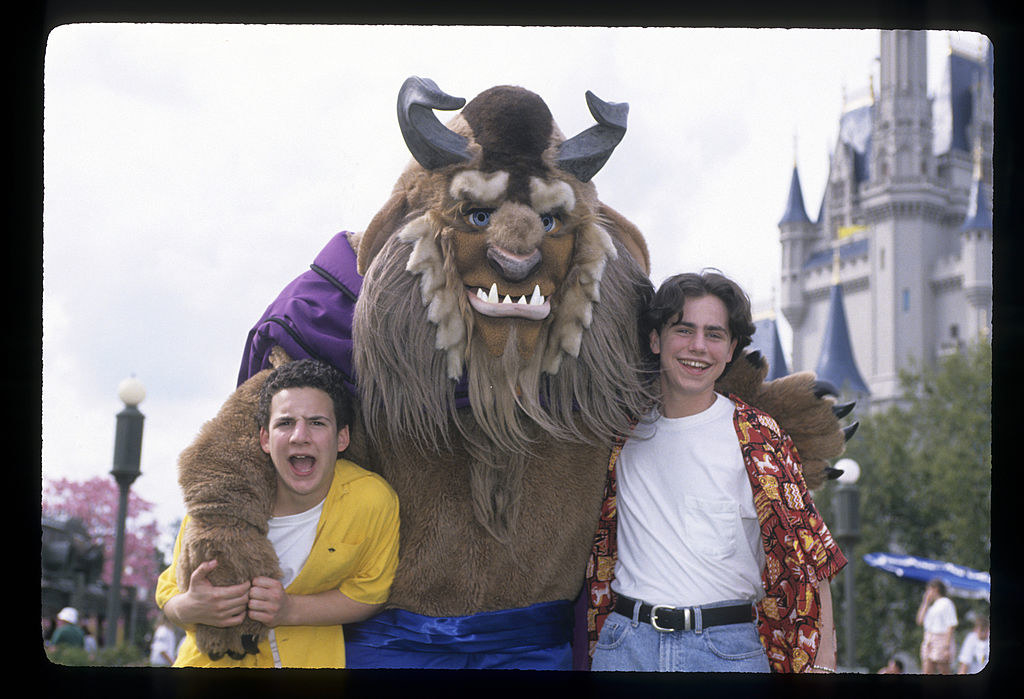 A photo of Cory and Shawn with Beast in front of Cinderella's Castle taken for an episode of Boy Meets World