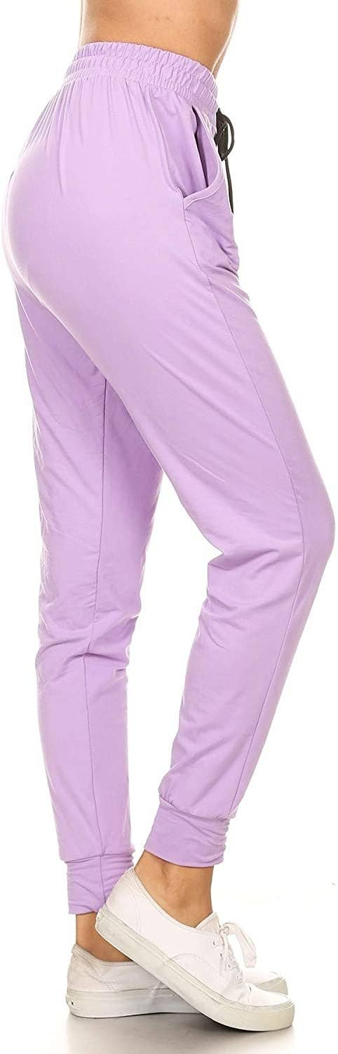 A model wearing the sweatpants in lilac
