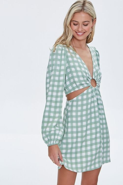 model wearing the dress in green and white gingham