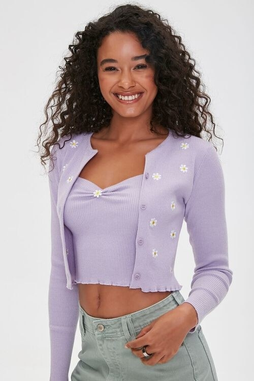 Model wearing the daisy print cardigan in lavender