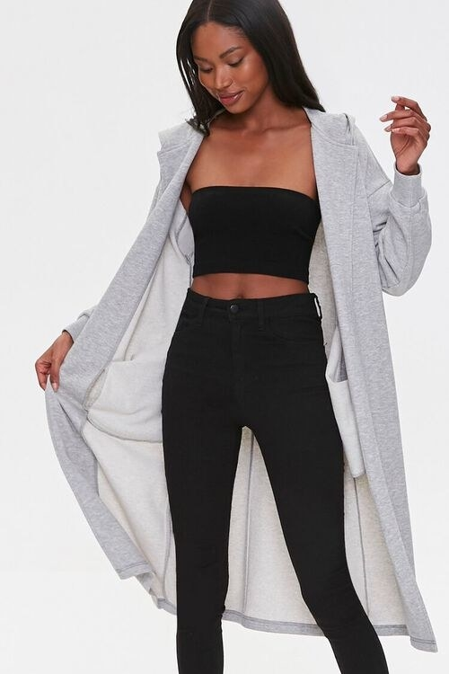 Model wearing the long grey sweater over a matching black top and pants