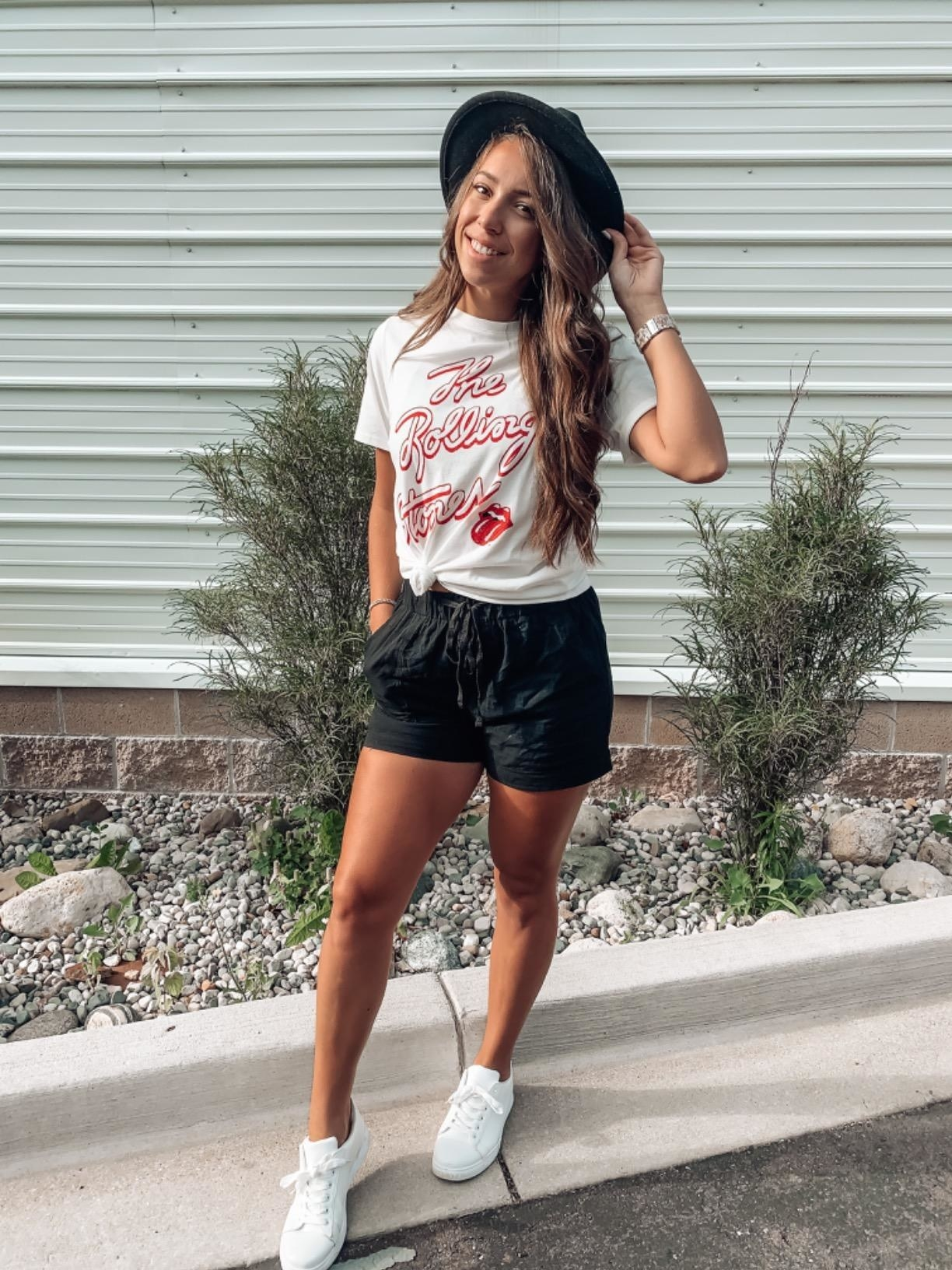 reviewer wearing the drawstring shorts in black