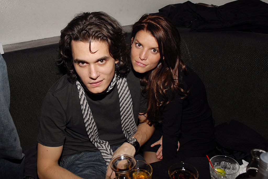John Mayer and Jessica Simpson at a table with drinks