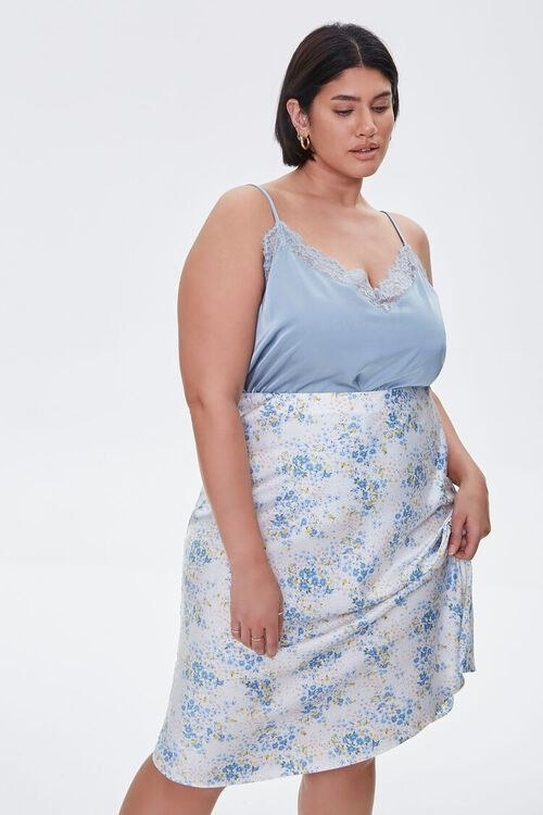 Model wearing the blue and white floral mid-length skirt