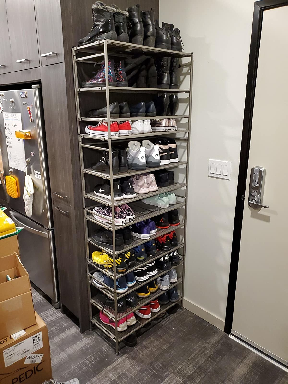 reviewer photo showing several of the shoe racks stacked together in their kitchen