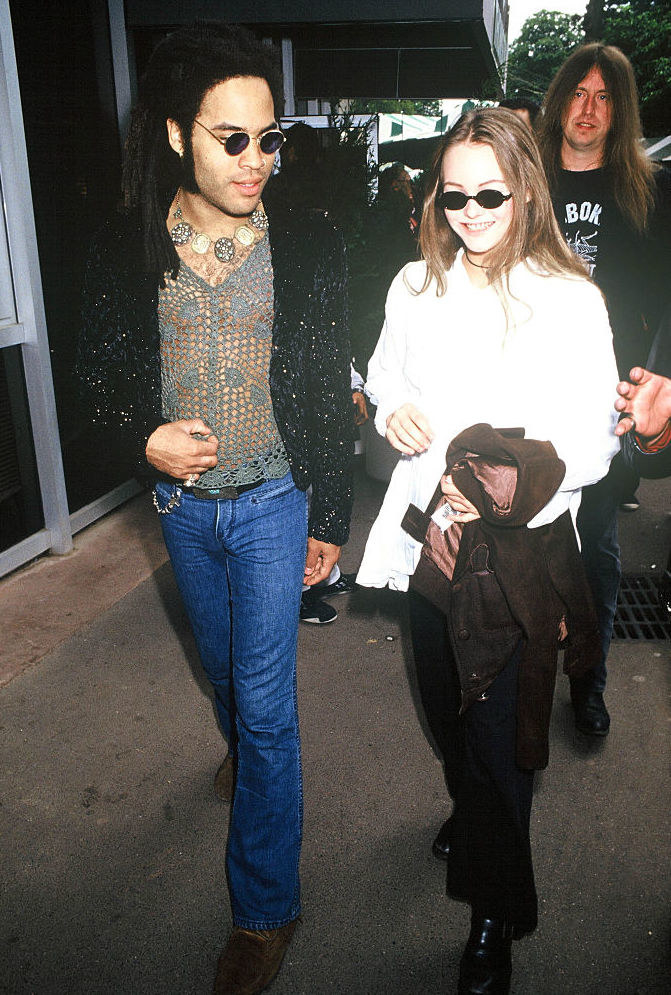 Lenny Kravitz and Vanessa Paradis wearing sunglasses and happily walking together, early 1990s
