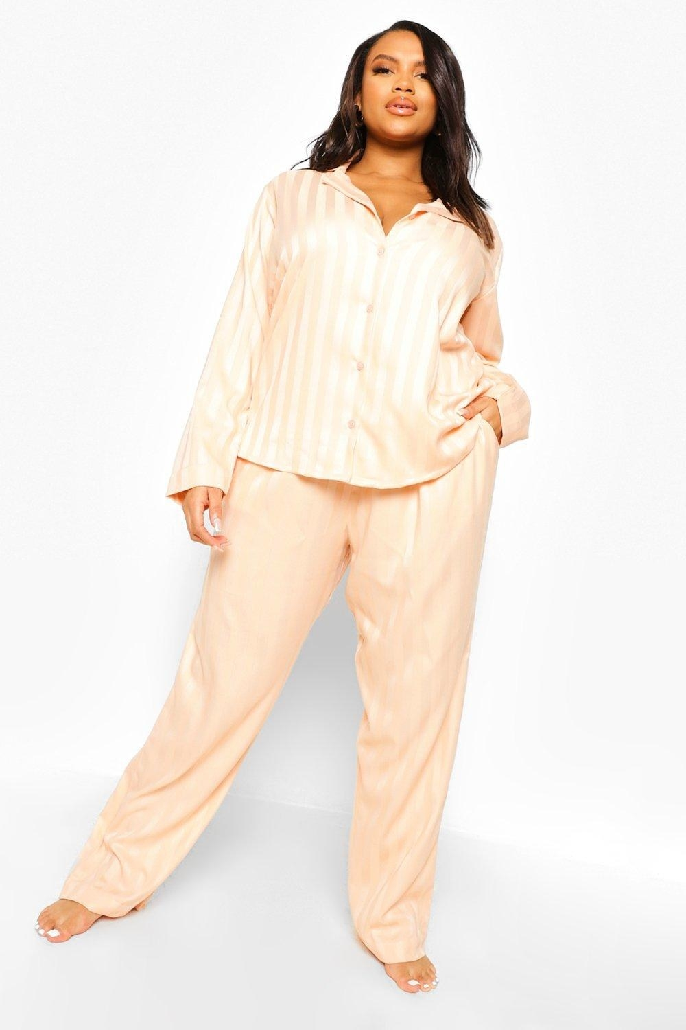 model wearing the pink and white striped pajamas