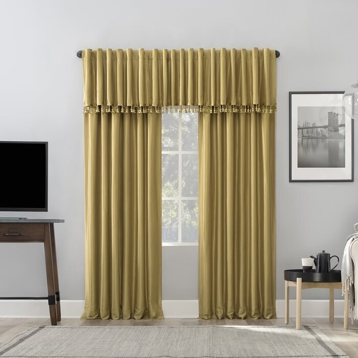 Mustard colored curtains with added cover on top. They hit the floor.