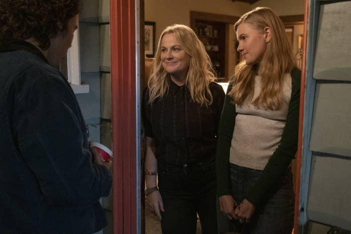 Amy Poehler standing in a doorway