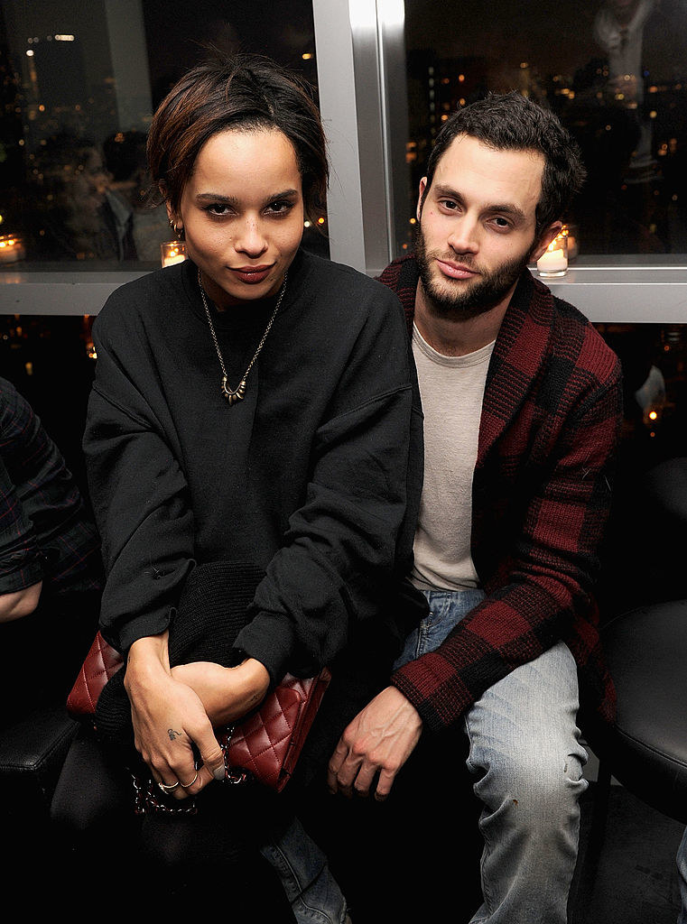 "Zoë Kravitz sitting on Penn Badgley's lap at the premiere of ""Warm Bodies"""