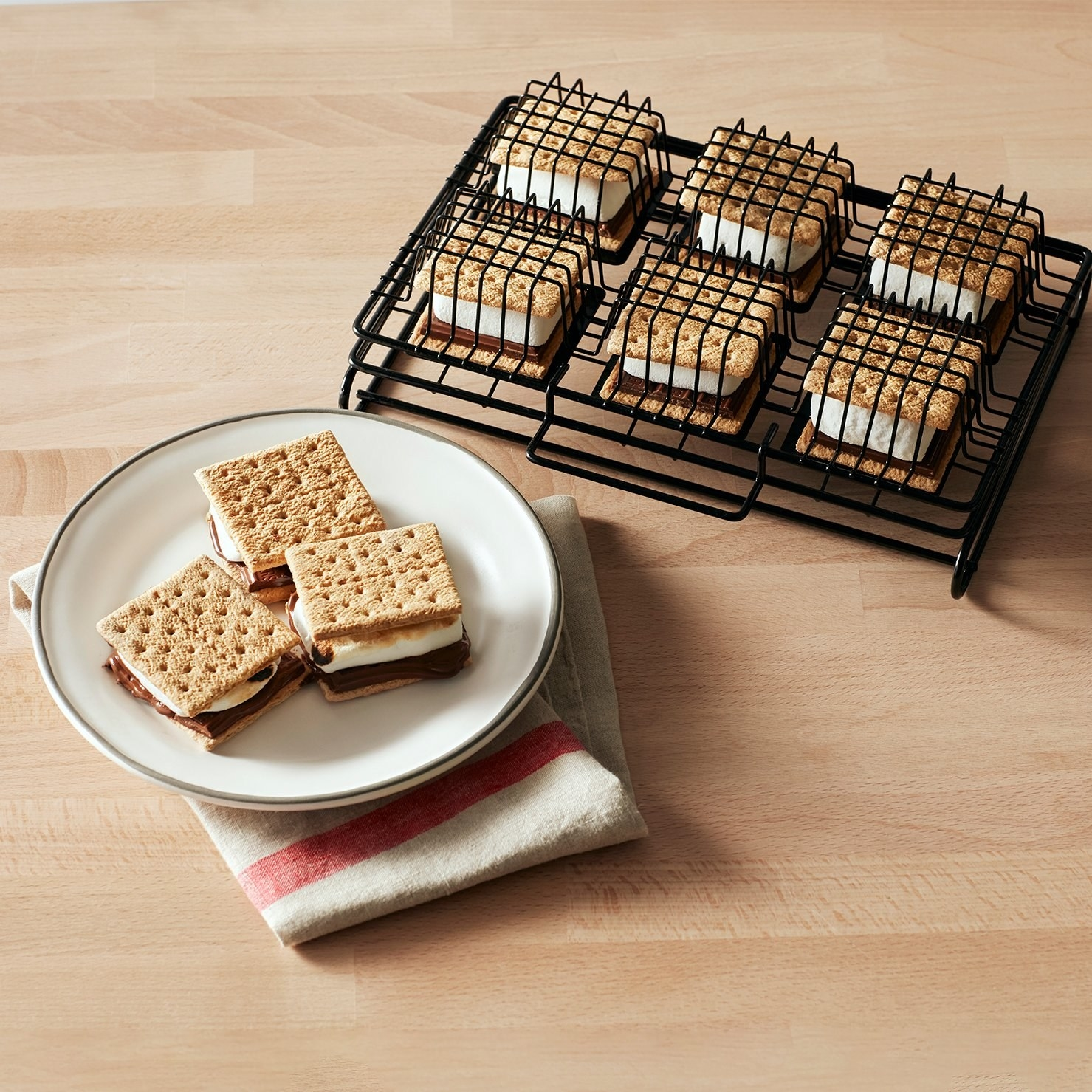the smores griller with cooked smores on a plate