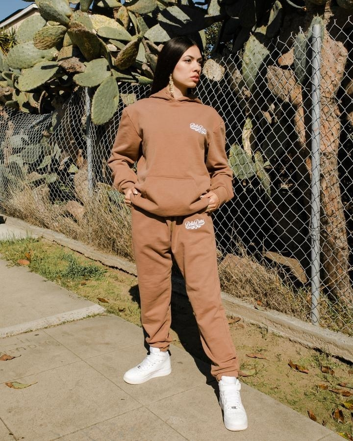 A model wearing the classic sweats in brown