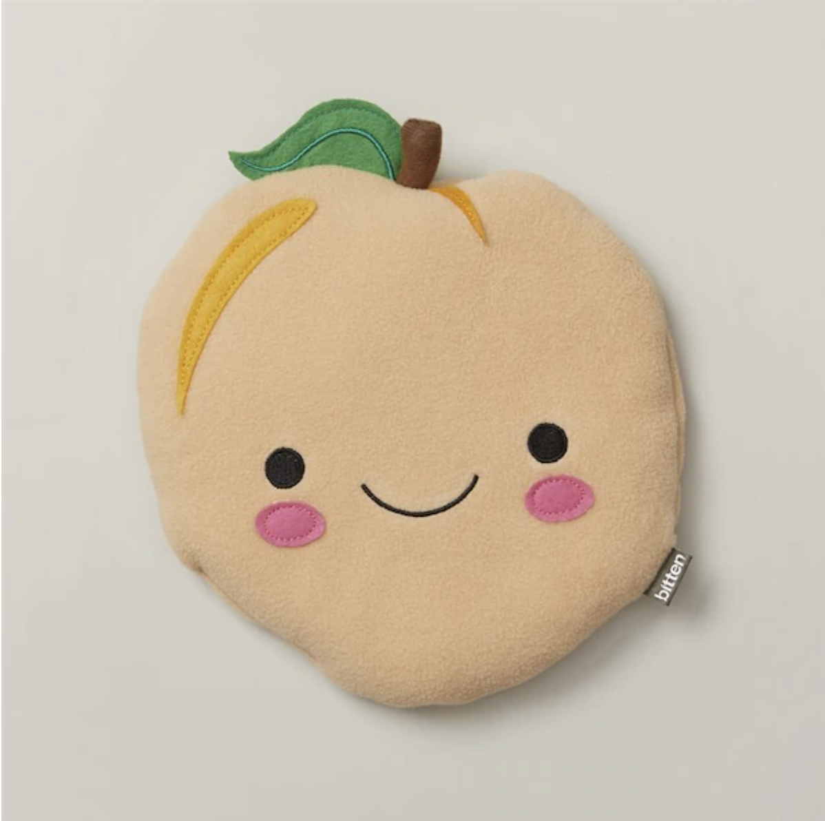 the peach pad smiling