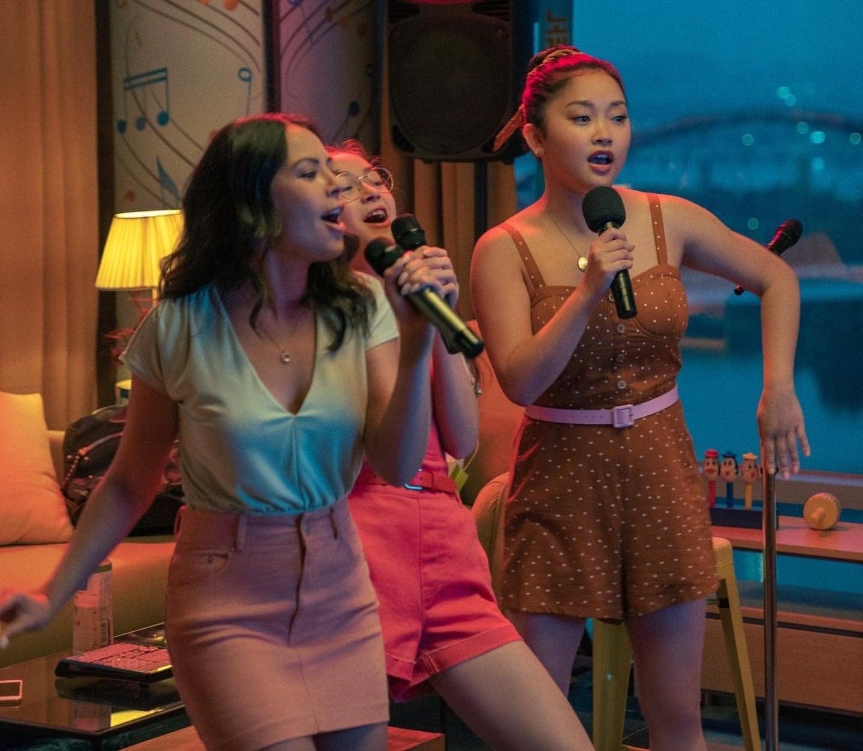 Lara Jean, Kitty, and Margot singing karaoke