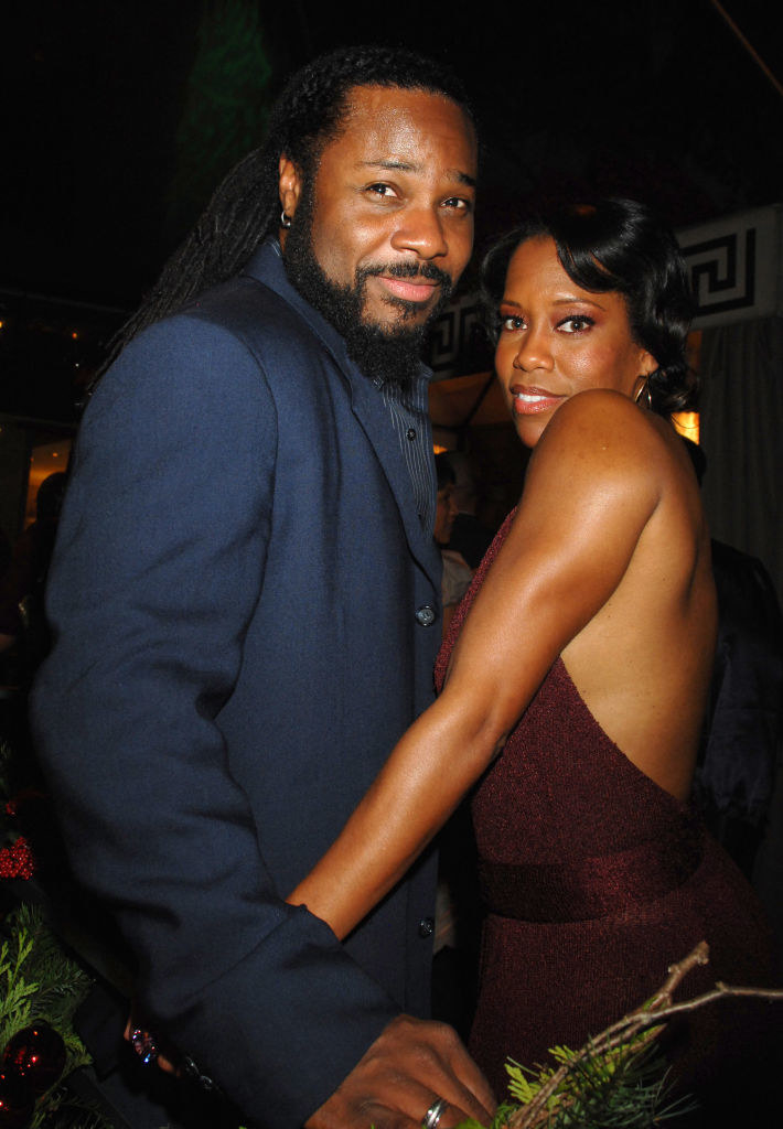"Regina King and Malcolm-Jamal Warner at the movie premiere for ""This Christmas"" in 2007"