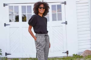 A model wearing the ankle pants in plaid