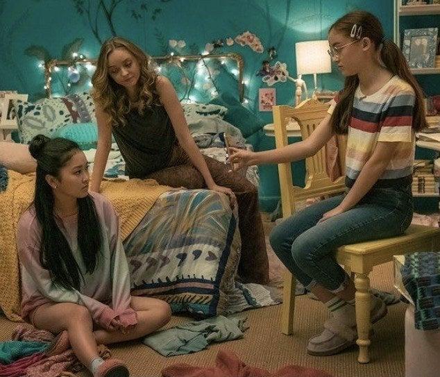 Lara Jean, Chris, and Kitty in Lara Jean's room