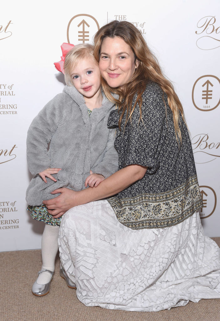 Drew posing at an event with one of her daughters