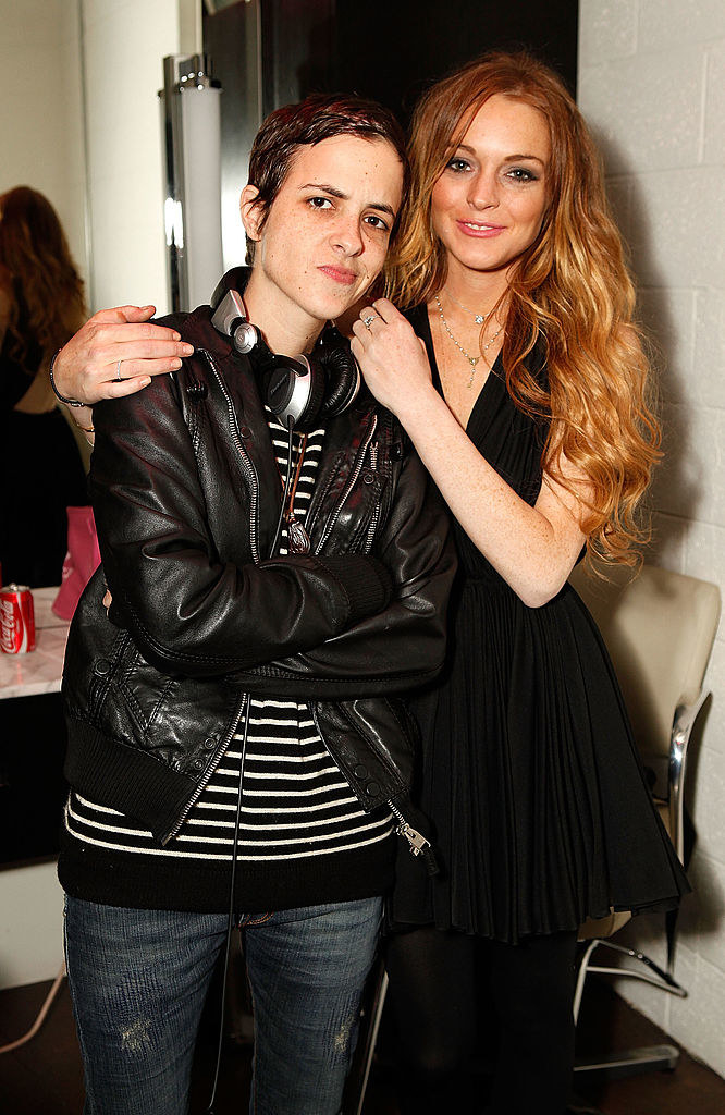 Lohan and Ronson posing together backstage at an event in 2009