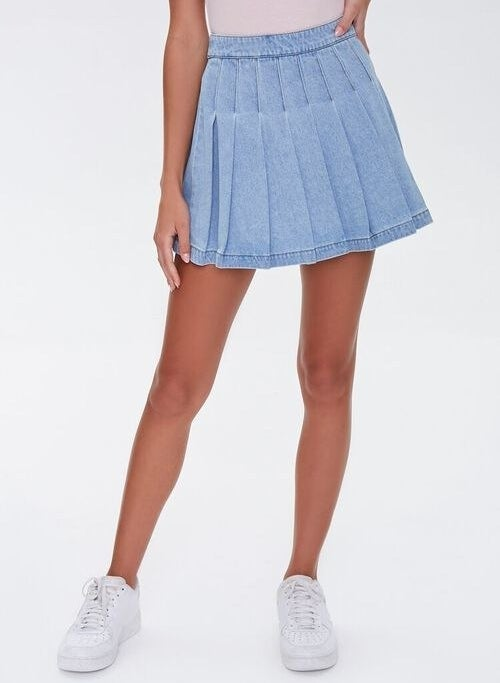 model wearing the denim pleated skirt