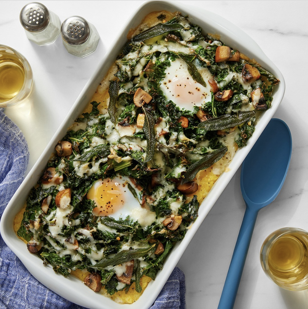 Baked Polenta and Eggs with Mushrooms & Crispy Sage in a rectangular dish