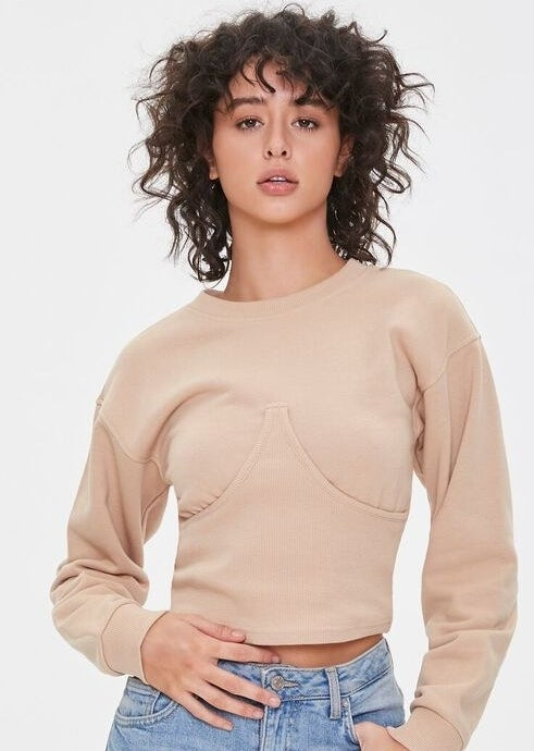 model wearing the bustier pullover in taupe