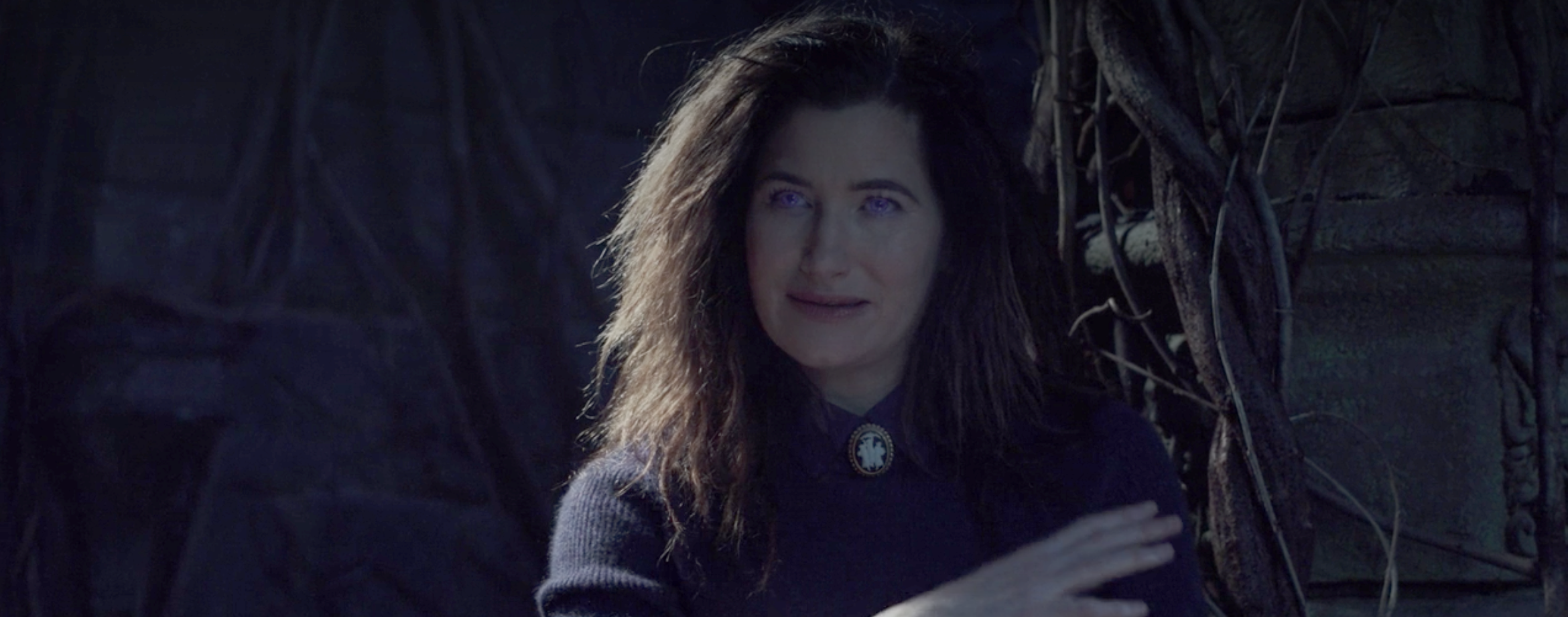 Agatha Harkness revealing herself with glowing eyes