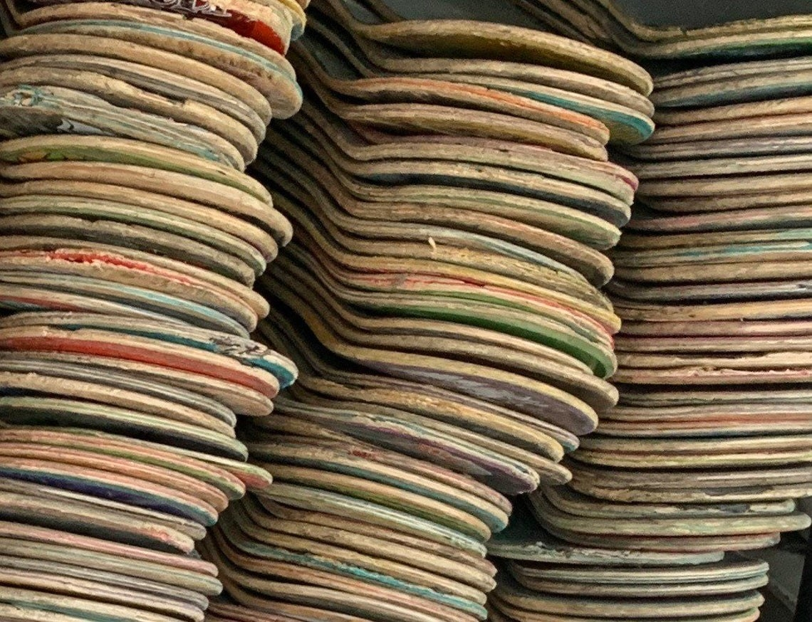 A stack of hundreds of used skateboards