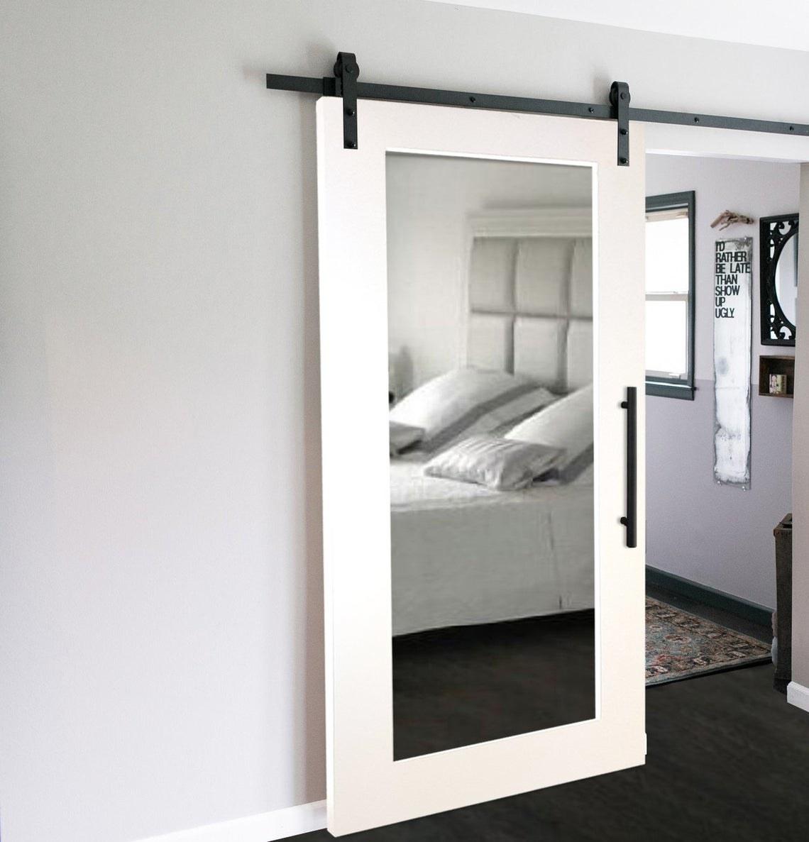 full length mirror mounted on a barn sliding door