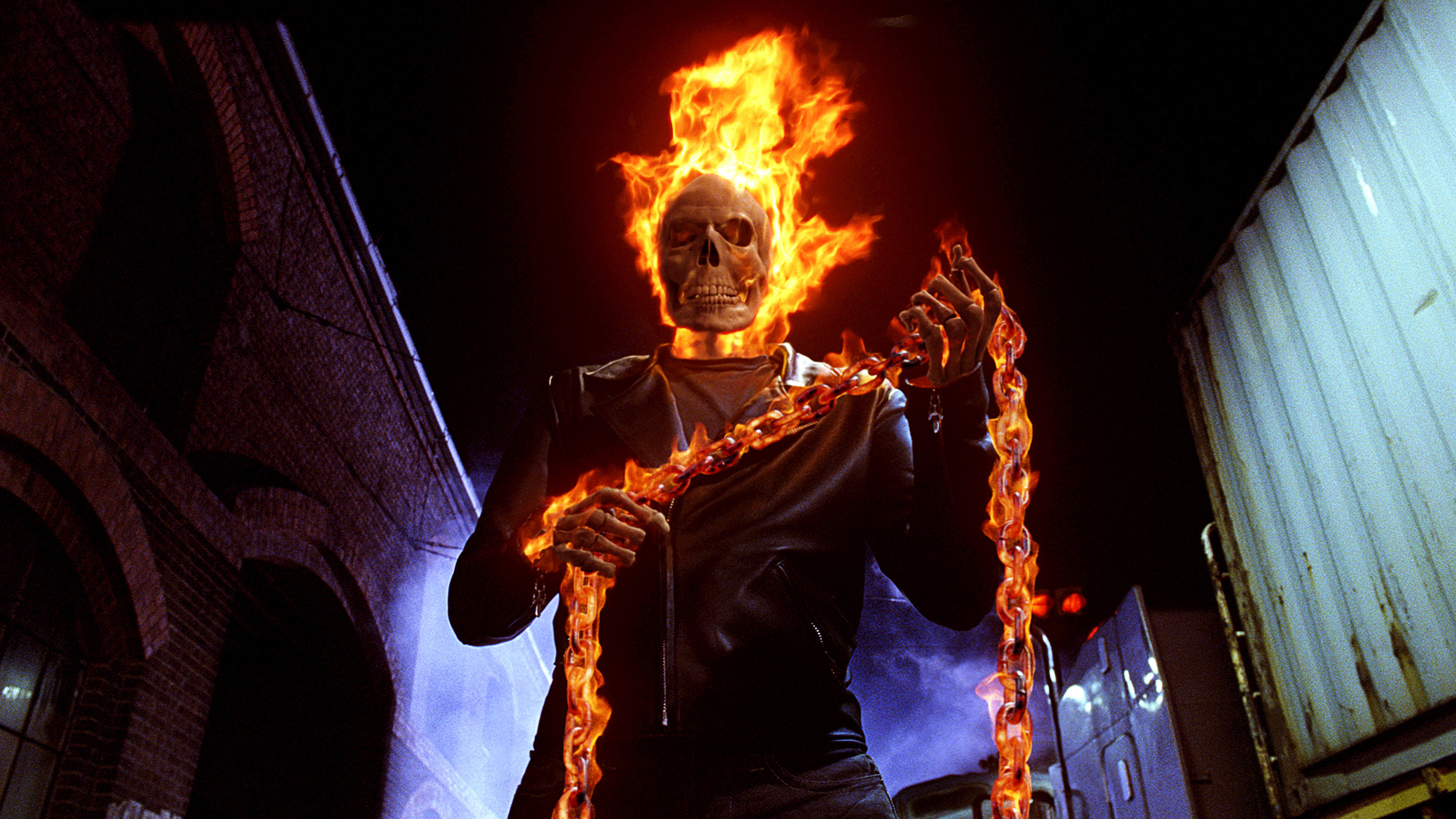 Ghost Rider holding a chain that is on fire