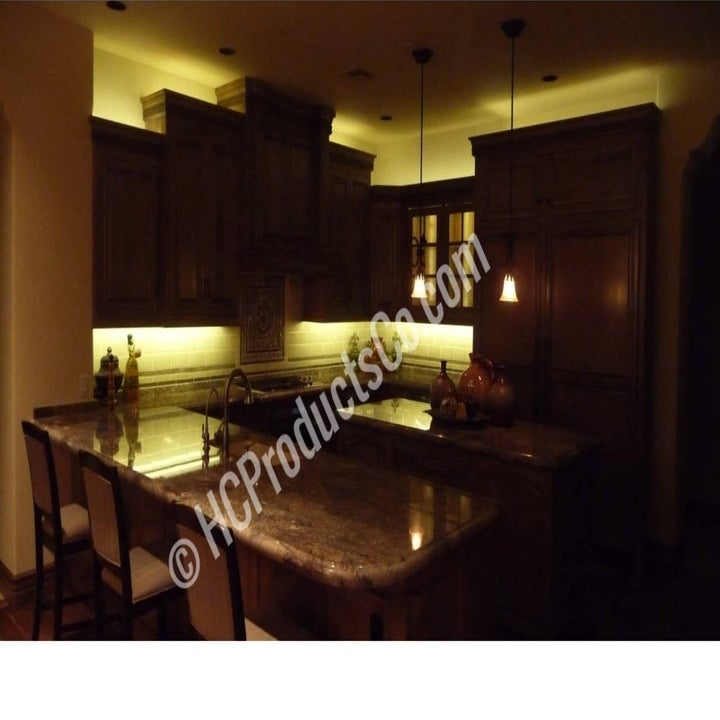 A set of cabinets with lighting above and below